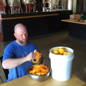 Harmonic co-owner Ed Gabbo, this time with the ingredients dominating him [Photo Harmonic Brewing]